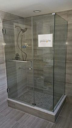 Wall Mounted Frameless Shower Door With An Inline Panel, And A Return  Panel. Channel Was Used To Secure The Panels. And A Handle/towel Bar  Combination Was ...