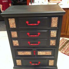 Cheetah and red chest of drawers.