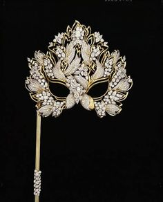 """The Elizabeth Taylor Diamond """"Lachrymosa"""" Mask, set with over 130 carats of diamonds in gold and platinum. Henry Dunay designed and made the """"Lachrymosa"""" mask in 1993 for Elizabeth Taylor with the proceeds benefitting the American Foundation for AIDS Research (AMFAR)."""