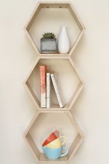 Natural Finish Floating Honeycomb Shelves @Pascale Lemay De Groof