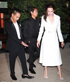 Style icon: A pair of sparkly high heels adorned her feet as the bottom half of the dress cut just above her ankle