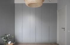 Minimalist built-in wardrobe, grey doors with recessed handles. Styling and photography Anu Tammiste