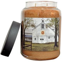 The Starburst Quilt Barn jar candle features a print from bestselling artist Billy Jacobs, and its Oatmeal Raisin Cookie scent is so authentic, everyone will think you've been baking!