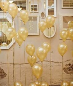Assemble dozens of gold balloons to quickly create a NYE photo booth backdrop.