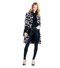 Play with a three-quarter sleeve evening coat by wearing a shrunken bomber jacket or blazer underneath. The feminine floral print begs for a tough note, which is what the black skinny jeans bring to the look.