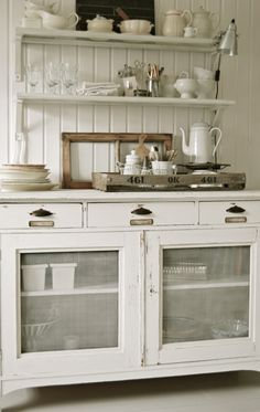 Repurposed Screen cabinet Fronts used to resemble an Antique pie safe ! In this Gorgeous Vintage Inspired kitchen !