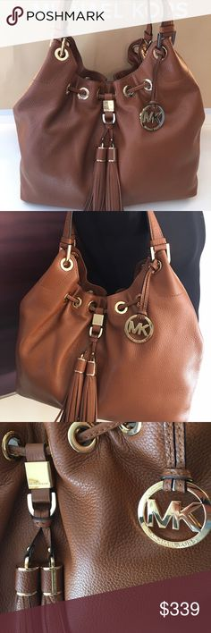 MICHAEL KORS NEW HOBO BAG 100% AUTHENTIC MICHAEL KORS NEW NEVER USED WITH TAGS PEBBLE LEATHER HOBO BAG.  THIS STUNNING AND STYLISH BAG OF SUCH A BEAUTIFUL SHADE OF LIGHT BROWN WITH GOLD HARDWARE AND DESIGNER TASSELS.  THE PERFECT BAG FOR ANY OCCASION. THIS BAG MEASURES 14 INCHES WIDE BY 12 INCHES TALL. THE SHOULDER STRAP HAS A 9 INCH DROP Michael Kors Bags Hobos