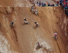Motocross riders compete in the Red Bull Hare Scramble race during Erzberg Rodeo near the village of Eisenerz in the Austrian province of Styria. (© Reuters)