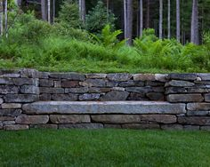 Stone garden seat, built into a retaining wall
