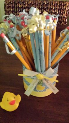 Pencil Holder for shower games -Purchased clear round container decorated with craft paper ribbon  & charm.  Filled with mix of plain & it's a boy pencils that I tied ribbon to- Perfect match theme