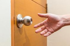 Photo about Male hand reaching out to grab a door knob, good for coming home, home safety or intruder concept. Image of white, entrance, reaching - 104597918 Door Knobs, Door Handles, Hands Reaching Out, Washable Area Rugs, Kitchen Sponge, Retail Logo, Male Hands, Home Safety, Cleaning Hacks