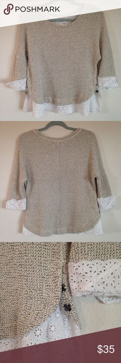 Anthropologie Nolina Pullover Sweater with Eyelet Anthro Saturday Sunday pullover with 3/4 sleeves. Oatmeal and black knit with lace eyelet trim at cuffs and hem. Snaps at side hems. Oversized fit, size M. 60% cotton, 40% acrylic and very soft. Great pre-loved condition. Anthropologie Sweaters Crew & Scoop Necks