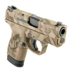 Available in traditional camouflage Shield® pistols will be sure to please. The durable Cerakote® will hold up to thousands of rounds . Smith And Wesson Shield, Smith N Wesson, M&p 9mm, Handgun, S&w Shield 9mm, Tactical Shotgun, Tactical Knives, Camo Guns, Military Guns