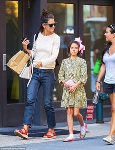 Cute as a button! Suri Cruise still looked every inch the cherubic youngster as she stepped out with her mother Katie Holmes in New York City on Thursday
