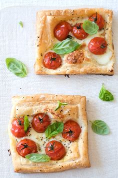 1 large sheet puff pastry   a little plain flour   1 fresh mozzarella, sliced   20 cherry tomatoes   salt and pepper   2 tablespoons olive oil   fresh basil  Preheat oven to 375F.  12-15mins