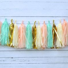 This wispy shabby chic garland will be a gorgeous touch to your peach mint gold party decor.  Many more party lovelies in our shop in your color scheme.