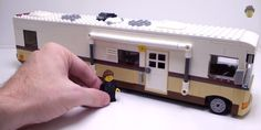 Jay made this LEGO motorhome in about a month. The model features many details found in large-scale motorhomes. Lego Camper, Lego Club, Camper Storage, Rv Accessories, Cool Lego Creations, Rv Hacks, Lego Projects, Lego Sets, Motorhome