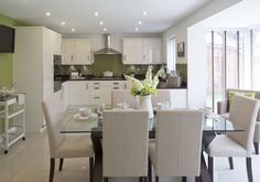 David Wilson Homes - Holden at Nursery Gardens, Bosworth Road, Measham  Kitchen/Dining Room idea using soft greens and french linen upholstered chairs