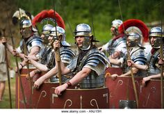 Roman soldiers with shields and weaponry at a Roman army reenactment, Chedworth Villa, Gloucestershire, UK - Stock Image