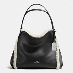 A fringe of soft shearling updates the Edie 31 with a plush, playful edge. Its striking leather exterior is matched by exceptional function inside, with three separate compartments designed for perfect organization.