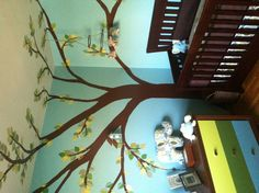 i love the tree mural with birdhouse & mobile incorporated