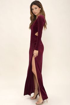 The Besame Burgundy Velvet Long Sleeve Maxi Dress will help you achieve that sultry, exotic look you crave! Luxurious velvet shapes a rounded neckline and long sleeves. An open back with top button sits atop a fitted maxi skirt with front slit.