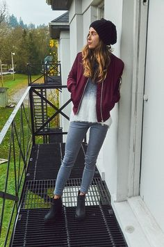 Stand out among other stylish civilians in a burgundy bomber jacket and grey slim jeans. Go for a pair of black chunky leather ankle boots to va-va-voom your outfit.   Shop this look on Lookastic: https://lookastic.com/women/looks/bomber-jacket-crew-neck-sweater-skinny-jeans/22946   — Black Beanie  — Burgundy Bomber Jacket  — White Fluffy Crew-neck Sweater  — Grey Skinny Jeans  — Black Chunky Leather Ankle Boots
