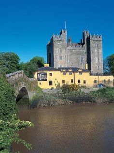 Bunratty Castle, Co. Clare, Ireland. with Durty Nelly's pub in the foreground. Visit for hotels in the area.