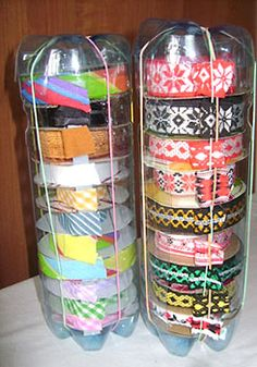 Forget ribbon, I see a Washi tape dispenser! Add a tear strip from an old foil box to the slot in the bottle for dispensing. Use a hot knife to cut the bottle for a smoother edge. Ribbon dispenser from plastic bottles. Plastic Bottle Crafts, Plastic Bottles, Soda Bottles, Plastic Pop, Pop Bottle Crafts, Drink Bottles, Craft Room Storage, Craft Organization, Organizing Ideas