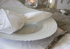 Silver and white Polynesian table setting