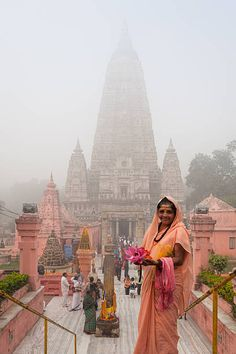 Buddhist pilgrim at Mahabodhi temple in a foggy morning. Bodh Gaya, Bihar, India. The Mahabodhi Temple (Literally: 'Great Awakening Temple') is a Buddhist temple in Bodh Gaya, the location where Siddhartha Gautama, the Buddha, is said to have attained enlightenment. Next to the temple, to its western side, is the holy Bodhi tree. In the Pali Canon, the site is called Bodhimanda, and the monastery there the Bodhimanda Vihara. ©Marji Lang