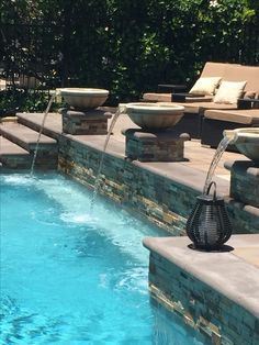 Remodeled Pebble Tech Pool with integrated spa-Added stacked stone, cement coping, built-in table with seating and water feature-Design/Finishes by Noble Abode Interiors, Orange County, CA, USA