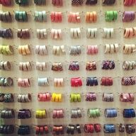 great washi tape storage idea using rubberbands and nails. I only wish I had this much washi tape. @ kelly purkey