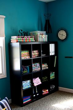 Love the Colors of this room! Maybe not a sewing area, but a craft area nonetheless :)
