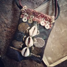 coins and cowry protective necklace by infinitystop