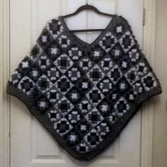 blue grey and white poncho