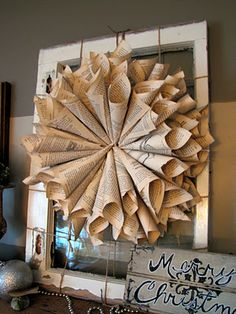 Love the book page wreath and rustic mantel.