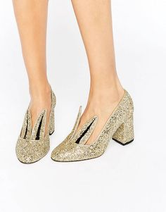 Buy Minna Parikka Jackie Gold Glitter Bunny Ear Heeled Shoes at ASOS. With free delivery and return options (Ts&Cs apply), online shopping has never been so easy. Get the latest trends with ASOS now. Gold Wedge Shoes, High Heels Gold, Gold Glitter Shoes, Fab Shoes, Gold Shoes, Shoes Heels Wedges, Slip On Shoes, Me Too Shoes, Women's Shoes
