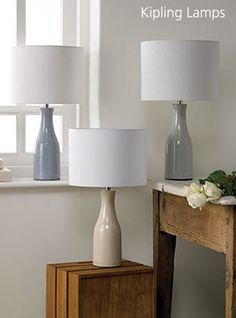 Kipling traditional 'one pint' bottle table lamps in blue, grey and cream. Curtain Fabric, Curtains, Country Cottage Interiors, Floor Lamp, Beautiful Homes, Bulb, Interior Design, Lighting, Table Lamps