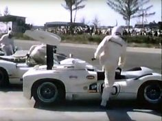 From a frame of ABC Sports video, Hap Sharp steps into his pole winning Chaparral 2E during the Le Mans type start for the Nassau Trophy race. Unfortunately, the car's Chevy V8 was reluctant to start. With assistance from mechanic Franz Weis, Sharp finally got the engine running and began the race dead last, nearly a full lap behind the leaders. He would storm forward to 3rd place by the last lap, when a mechanical failure led to a spin and crash.