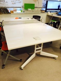 We found it! This conference table has it all. Sleek design, marker board top, power in the top, folds up, AND its a ping pong table!! @scale1to1inc @neoconshows #workspacevision #worklifebalance  #conferencetable #innovativedesign #funintheoffice