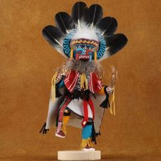 Navajo War Dancer Kachina Doll has a spectacular face!His head & horns are back-dropped with hand dyed feathers. Trimmed with rabbit fur, shells & fringe. Native American Artists, American Indians, Body Proportions, Rabbit Fur, Navajo, Nativity, Feathers, Hand Carved, Backdrops