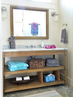 Bathroom vanity from Restoration Hardware and chrome sconces from SchoolHouse Electric