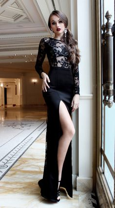 CHANEL O'DELL the formal gown with low back, high split, lace up, and lace sleeves. All black everything.