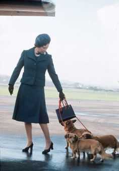 Queen Elizabeth of course with my favourite corgies