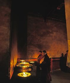 Monks infront of butter lamps at  Ramoche Temple in Lhasa, Tibet.    The Tibetan Nuns Project http://tnp.org    Brian Harris Photography http://www.brianharrisphotography.net