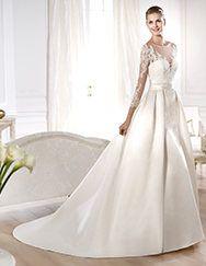 Pronovias presents the Odette wedding dress. Costura 2014. | Pronovias