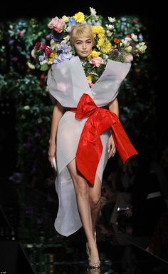 Gigi Hadid rocks flower dress at Moschino LFW show   Daily Mail Online