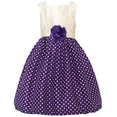 Trendy dress with a fitted bodice and a flared voluminous skirt from designer Mia Juliana. The dress has a sleeveless ivory bodice and a purple ivory polka dotted skirt. A cute fabric flower adorns the waist. Zips up at the back. Crinoline lining is firm