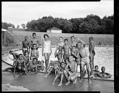 Singer Carol Thompson, poses with newsboys at the edge of Sully Pool in South Park during Pittsburgh Courier newsboys' annual picnic, August 1961.